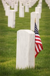 Arlington Cemetery or Tomb of the Unknown with USA Flag