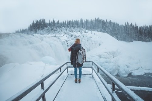 woman traveling in winter with backpack