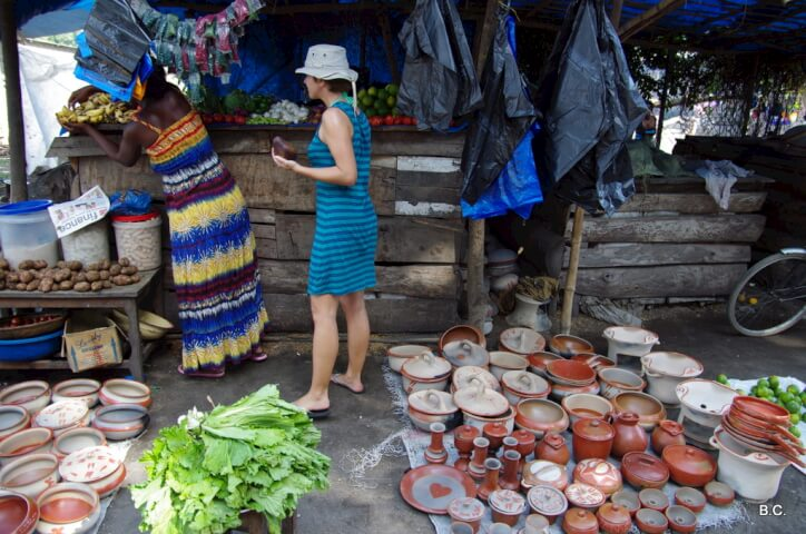 Stocking up on fresh fruit and veggies at a local market in Tanzania.