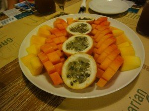 A delicious platter of passionfruit, mango and papaya.