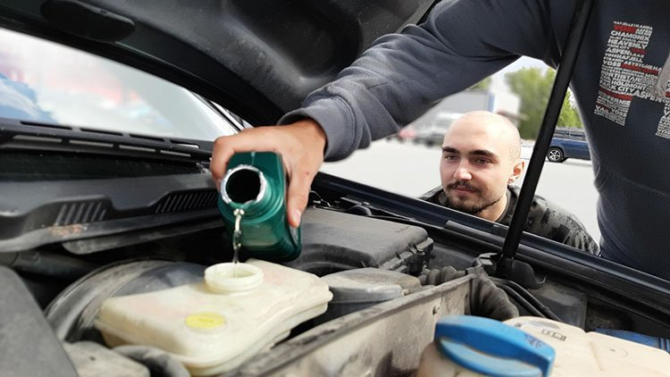 Putting oil in the car