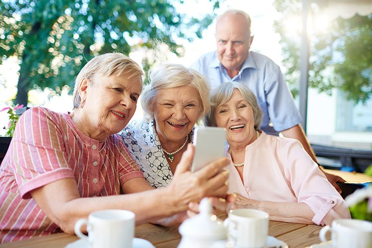 Seniors friends laughing together