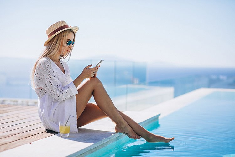 Woman checking on phone while on vacation